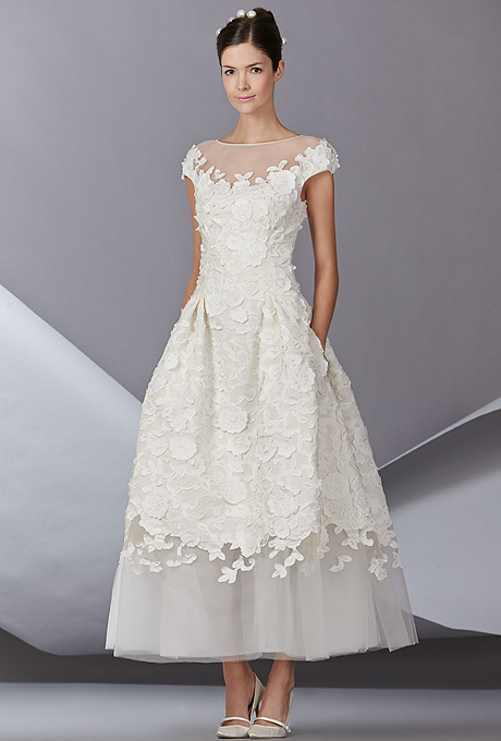 """Bettina"" ankle-length tulle A-line wedding dress with an illusion bateau neckline and floral embroidered details over the bodice, skirt, and cap sleeves, Carolina Herrera"