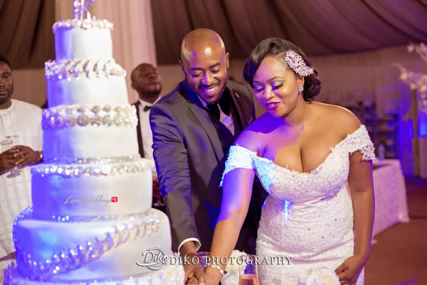Nigerian Couple cutting the cake Judith & Kingsley Diko Photography LoveweddingsNG