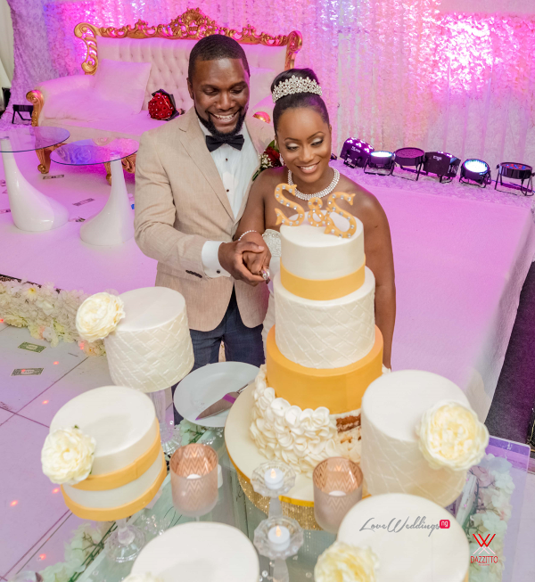 Nigerian Wedding in London Seun and Segun Bride and Groom Cutting Wedding Cake LoveweddingsNG Dazzitto Photography