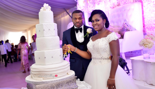 Nigerian White Wedding - Bride and Groom Folake Cutting the Cake Ifeoluwa Reception Outfit Klala Photography LoveweddingsNG