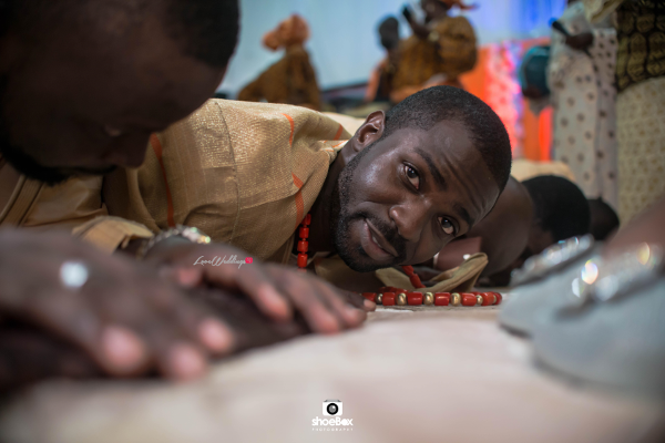 nigerian-traditional-groom-prostrating-dobale-moji-and-fola-loveweddingsng