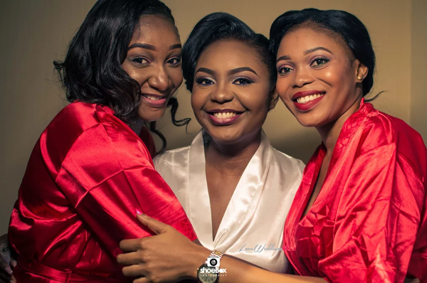 nigerian-bride-and-bridesmaids-in-robe-aloy-and-grace-sculptors-evens-loveweddingsng