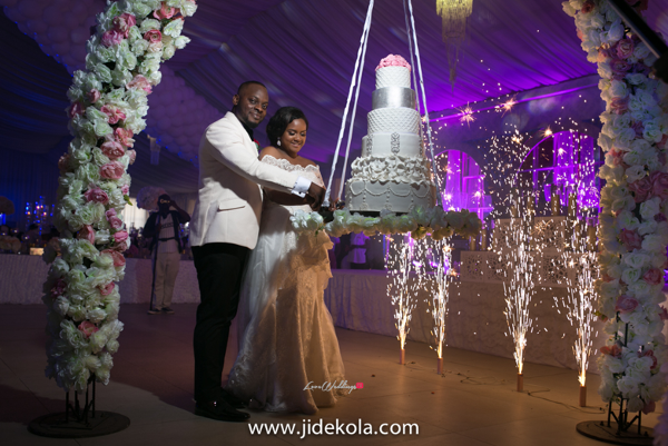 nigerian-couple-cutting-suspended-cake-faji2016-jide-kola-loveweddingsng