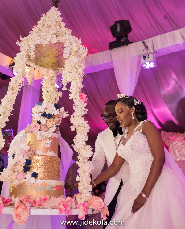 Nigerian Couple Cutting the Wedding Cake - Prince Kasali and Olori Abisoye Jide Kola LoveWeddingsNG