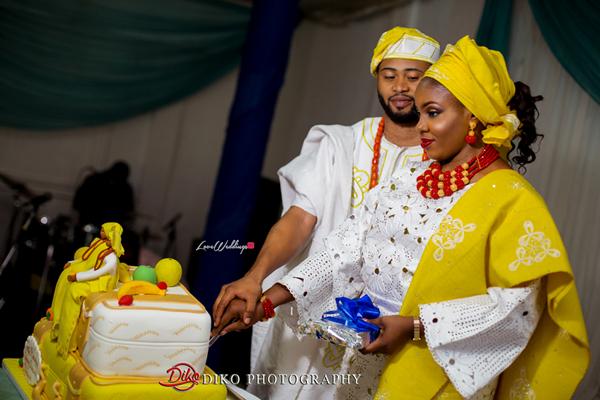 Nigerian Traditional Wedding - Bunmi and Mayowa couple cutting the cake LoveweddingsNG 1