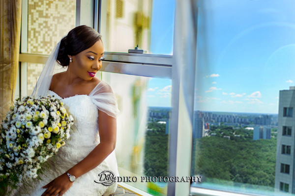 Nigerian Bride Looking Out The Window Grace and Pirzing LoveweddingsNG Diko Photography