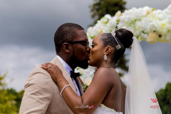 Nigerian Wedding in London Seun and Segun Bride and Groom Kiss LoveweddingsNG Dazzitto Photography
