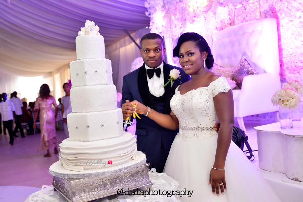 Nigerian White Wedding - Bride and Groom Folake Cutting the Cake Ifeoluwa Reception Outfit Klala Photography LoveweddingsNG