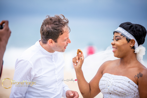 nigerian-italian-beach-wedding-feeding-cake-irene-adams-luca-tomasi-raremagic-gallery-loveweddingsng-2