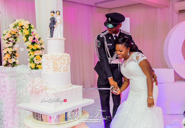 nigerian-police-wedding-ify-and-chisom-cutting-the-cake-the-event-girl-ng-loveweddingsng