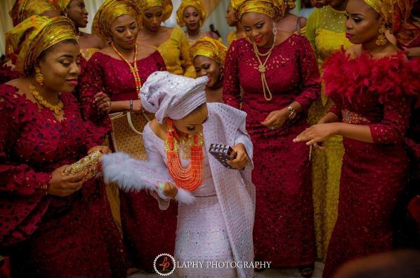 nigerian-bride-and-asoebi-ladies-princess-layebi-tejuosho-and-lekan-aluko-traditional-wedding-loveweddingsng-2
