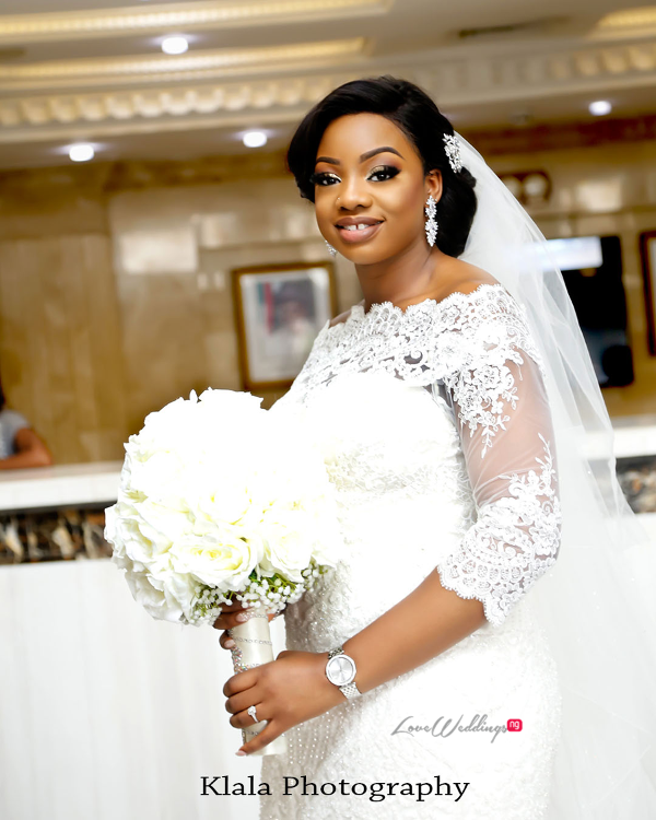 Nigerian Bride and bouquet The Fadinas Bridal Party Klala Photography LoveWeddingsNG 1