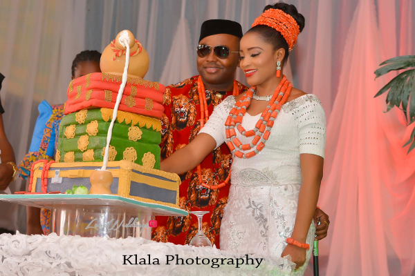 Nigerian Bride and groom cut wedding cake Ifeyinwa and Chidi Traditional Wedding Klala Photography LoveWeddingsNG