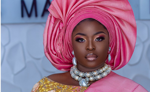 This pink and gold traditional shoot is perfect for a Nigerian bride