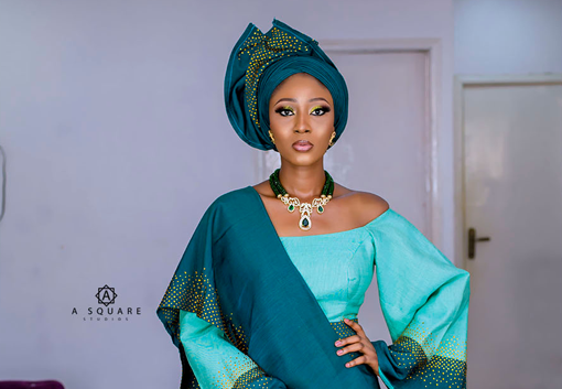 This traditional bridal look features gorgeous shades of green