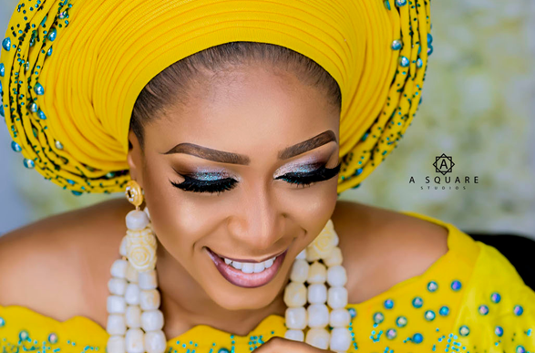 This yellow & green studded traditional bridal look is stunning!