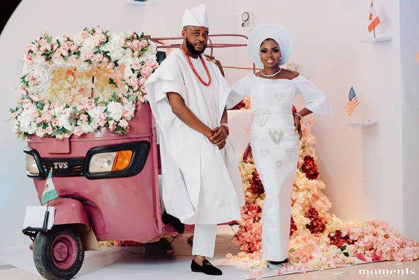 This floral car booth is parking up at a lot of Nigerian wedding receptions